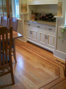 "3/4"" x 3 1/4"" white oak hardwood flooring with custom border and cherry feature strip"