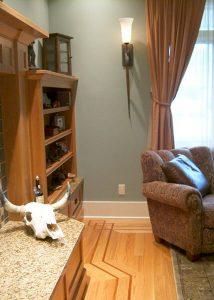 White oak hardwood flooring with custom border and cherry feature strip